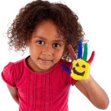 kid with a painting in her hands